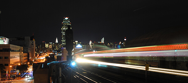Energy Technology: shot of LaGuardia at night with the 7 train passing by